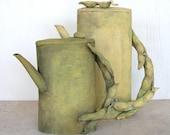 Handbuilt  sculptural earthenware teapot. Sculptural, decorative, fava beans, vegetables, spring, summer.