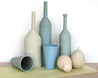 Still life with two pears. Bottles, fruit, blue, tan, spring, seaside, mantle piece, wedding, housewarming.