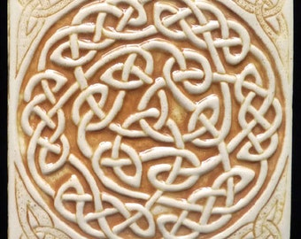 Decorative, relief carved ceramic Celtic knot tile
