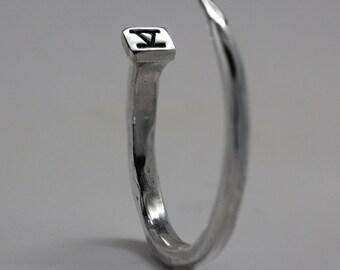 silver nail bracelet in white bronze