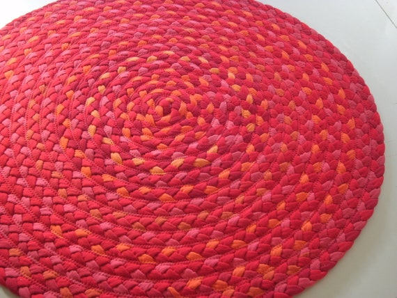 """READY TO SHIP 31"""" poppies rug with reds pinks and orange some New organic fabric and recycled t shirts"""