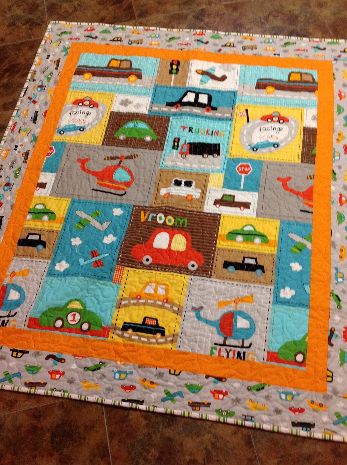 Baby boy crib quilt vroom 2 cars trucks blue brown for Quilt material for boys