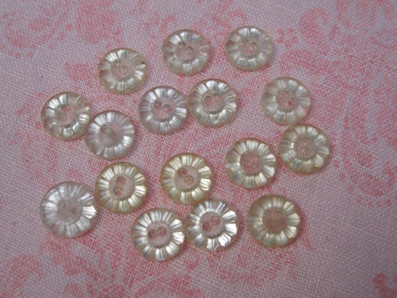 Vintage assorted flower prism design clear yellow tint plastic buttons. Wholesale lot set of 16.