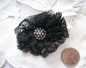 Antique black silk lace rosette with cut steel center
