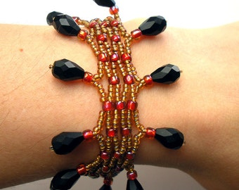 Lacey Handmade Woven Bracelet with Gold Crimson Seed Beads Black Glass Drops and Gold Leaf Toggle