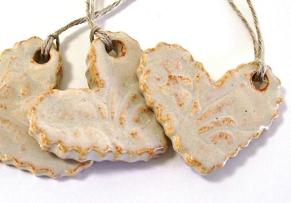 three ceramic heart ornaments christmas tree ornaments holiday ornaments gift tags rustic cream handmade stoneware pottery