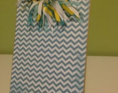 Teal Cheveron Print with a yellow and white polka dot print backed
