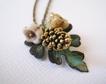 Autumn Leaf with Gold Pinecone Necklace.verdigris patina leaf, antique gold pinecone, and autumn flowers.