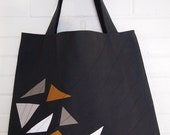 Triangle canvas tote style hand bag in Black.