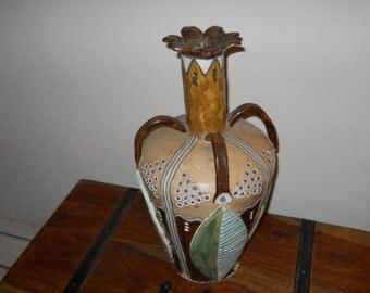 "Ceramic sculpture with ""leaves"""
