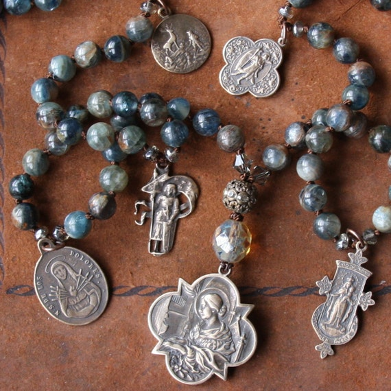 kyanite and religious charms long necklace....