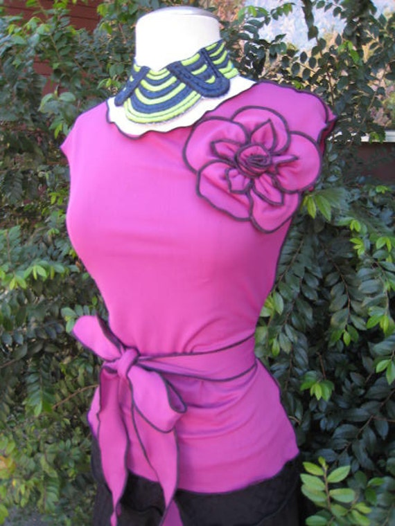 Fuchsia color sleeveless top with rose decoration and plus a belt connected for decoration plus made in USA