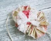 Now or Nectar coral and cream floral frayed fabric ruffle and rosette headband