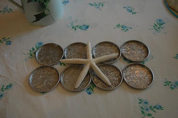 Eight Vintage Everlast Hand Forged Aluminum Coasters at Retro Daisy Girl