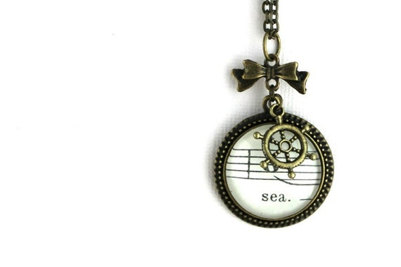 Nautical vintage style necklace made with real sheet music under glass with bow and ship wheel charms antiqued bronze