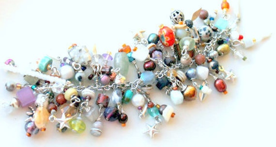 fringe necklace. layered muted color filled wire wrapped beads charms beaded uniquenecks jewelry