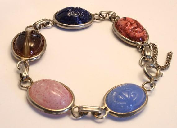 Vintage glass scarab bracelet. Multi color