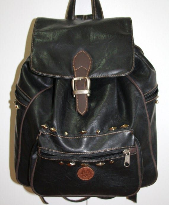 Studded Black leather backpack, with buckle
