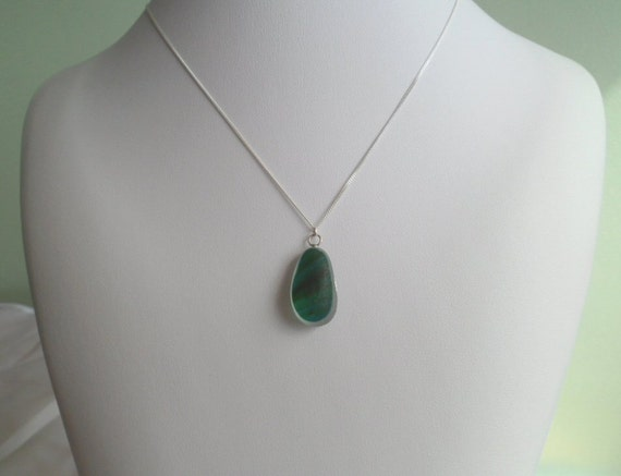 Very rare Multi several layers of diffrent shades of greens Victorian English seaglass pendant  sitting on ice white frosted base ASG30