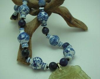 Carved jade bird pendant necklace