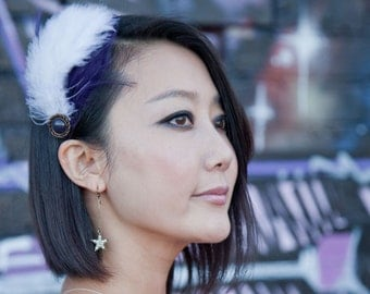 Purple feather headband with white feathers and vintage button adornment