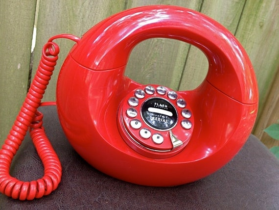 vintage donut phone - 1970s bright red circle telephone