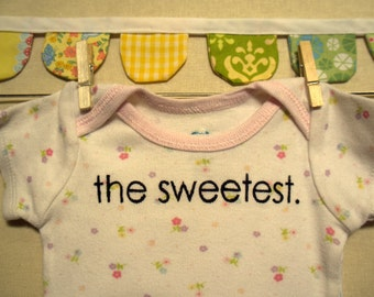 the sweetest --- white patterned bodysuit, size newborn