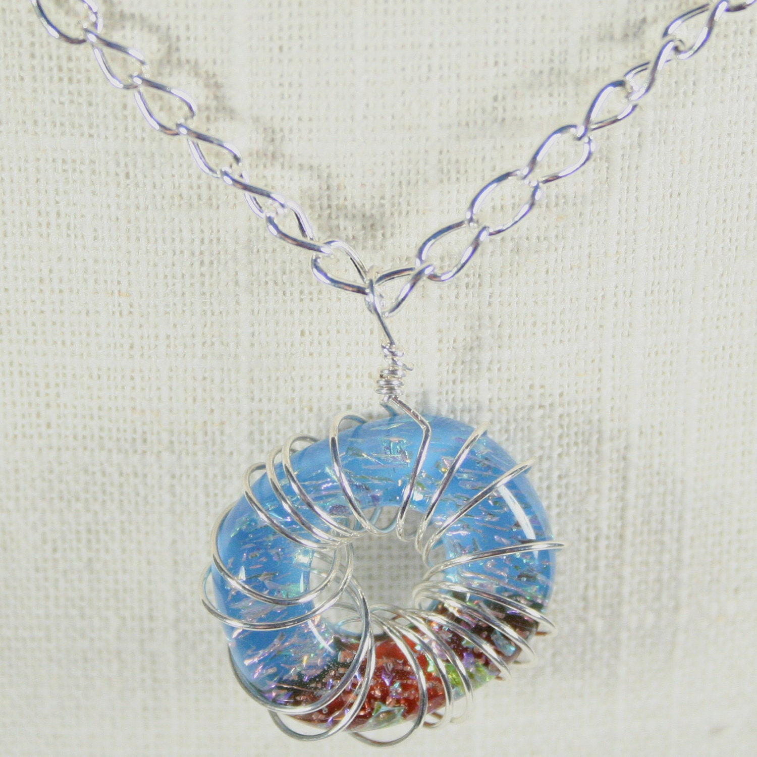 Necklace: Glass ring necklace, Blue and red necklace, wire wrapped necklace