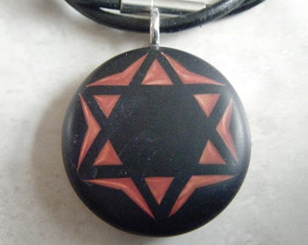 Star of David  hand cparved on a polymer clay black color background. Pendant with a FREE necklace