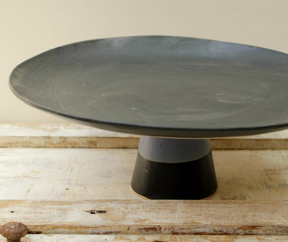 Big black cake stand with a touch of purple for a lovely dessert