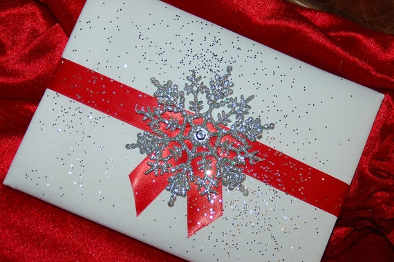 Glistening Snowflake White Satin Fabric Covered Guest Book with Red Accent Colored Ribbon