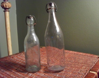 Lot of 2 Antique Wire Lid Bottles