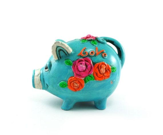 Neon piggy bank - OSL 1971 psychedelic chalkware bank teal tangerine tango pink flambe