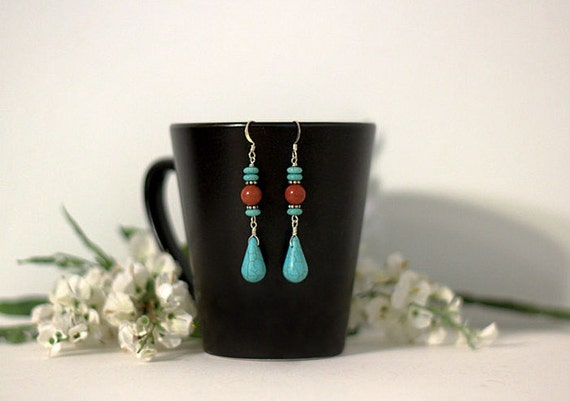 Turquoise Howlite and red-orange dangle earrings