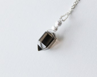 Dark Pendulum Necklace --- a smoky quartz point with silver beads on a delicate chain