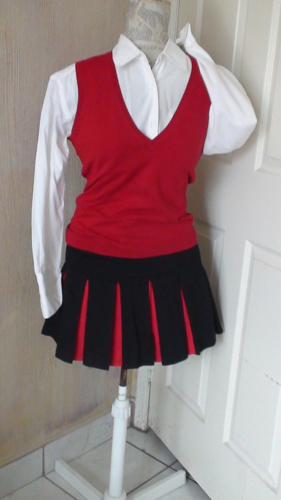 Cheerleader skirt in red and black. Cotton and Lycra. Made in the USA