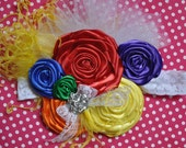Rainbow Bright couture vintage inspired fabric rosette headband in bright colors new born to adult great photo prop