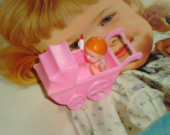 Retro Small Pink Plastic Baby Buggie with Baby