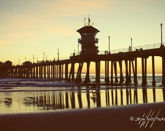 California Summer Sunset - Surfer walking under the HB Pier as the sun sets 8x12 photo