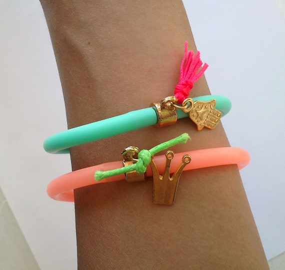 SALE--- ONLY 7 DOLLARS-----Neon peach rubber bracelet with gold planted crown charm