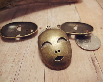 6pcs of Antique Bronze Smiling Metal Mask Charms 35x25mm P24-HK9650