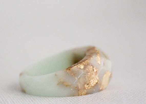 mint and gold multifaceted eco resin ring with suspended gold flakes
