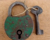 Very old large french metal padlock with handmade key