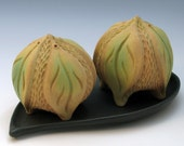 Hand carved tan and green salt & pepper shakers with leaves