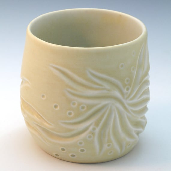Carved porcelain cup in pale yellow glaze