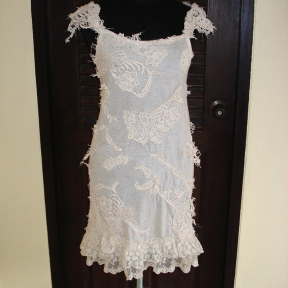 shabby chic...vintage ivory slip laden with shabby pieces of crochet, and ruffle lace trims...