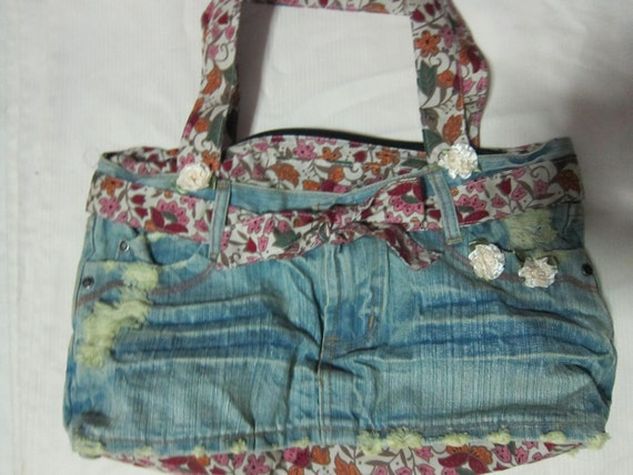 all cotton denim and vintage print  bag....lined with 2 lots of inside pockets...