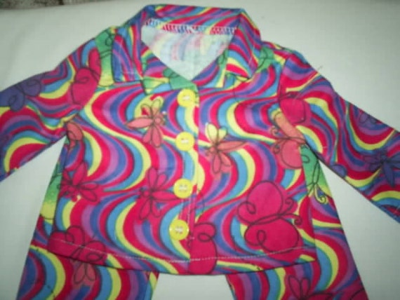 Pajamas with swirlly rainbow colors and butterflies for american girl doll