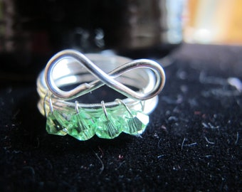 Wire wrapped infinity AUGUST birthstone ring with green peridot crystals, can be made in any size