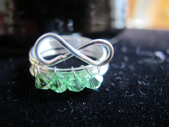 Wire wrapped infinity AUGUST birthstone ring with green peridot Swarovski crystals, can be made in any size